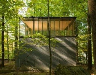 Minimalist retreat and study cube in the forest
