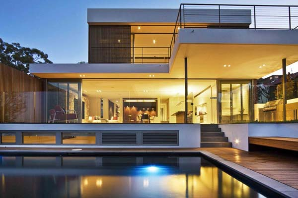 Warringah Road House Sandstone, timber and glass combined: The Warringah House by Corben Architects