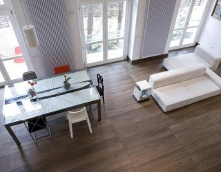 Minimalist loft flooded by natural light, designed by Nicola Auciello