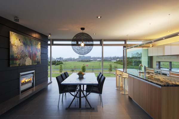 Bright and minimalist new zealand holiday home for Holiday home designs new zealand