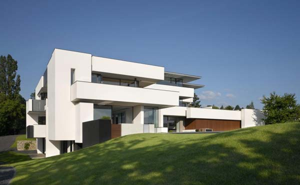 Oberen Berg House Multi generation residence shaped out of white cubes