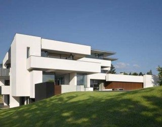 Multi-generation residence shaped out of white cubes