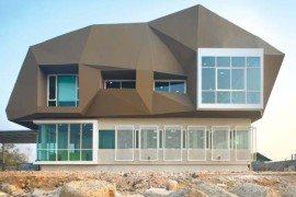 Unusual shipbuilding office design resembling a meteorite