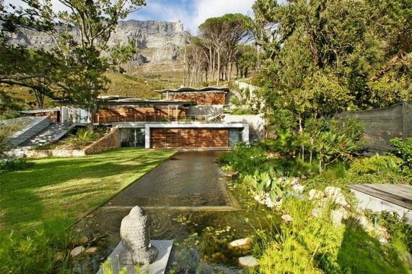Beautiful mountain house blends in with the landscape for House on a mountain