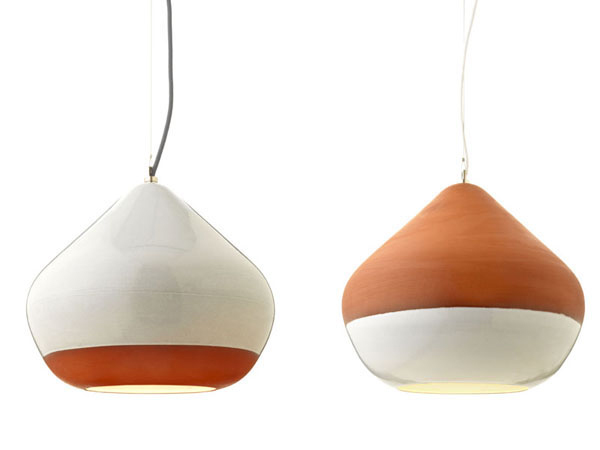 Terracotta Lamps Elegantly hanging over the dining table: Terracotta Lamps