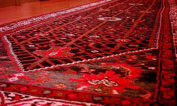 Red rug Basic Rug Cleaning and Care Tips