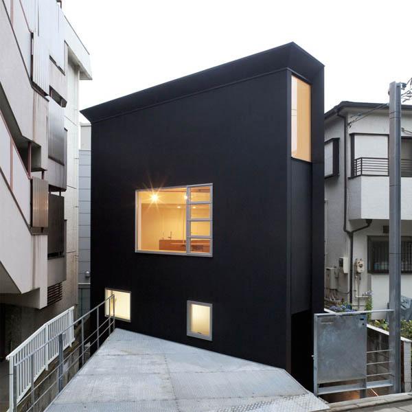 Narrow Japanese home with voluminous interiors 1