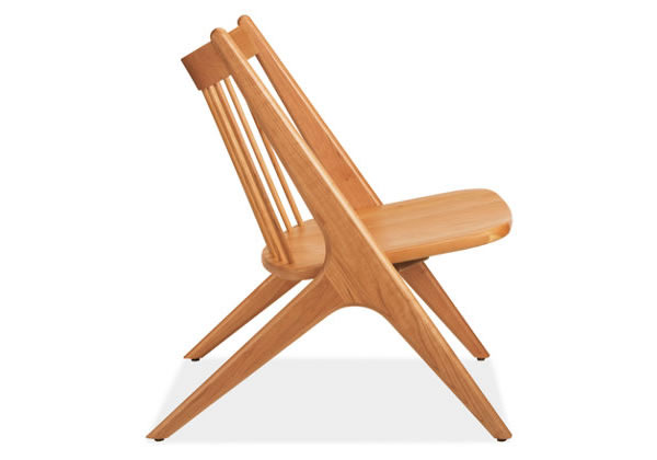 Sculpted Oskar Armless Lounge Chair Showcasing the Beauty of Wood