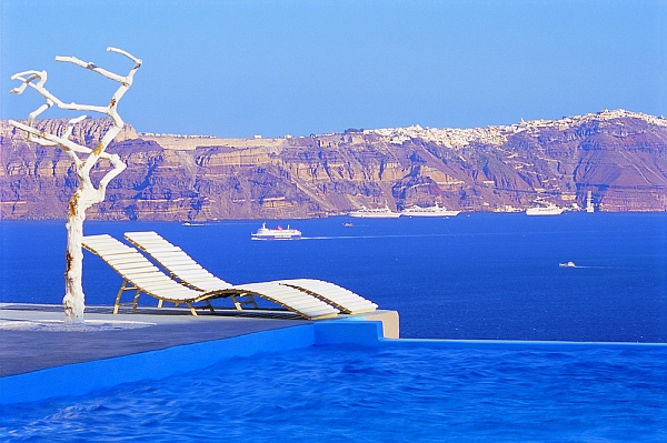 Astarte Suites Santorini lounge exterior pool Astarte Suites: Honeymoon Destination in Santorini, Greece