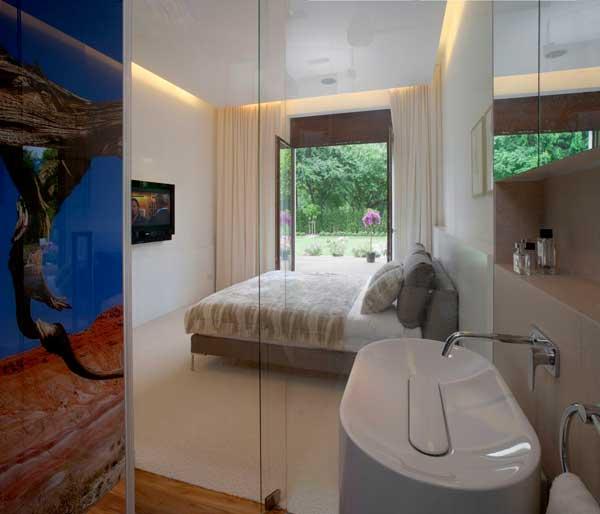 Contemporary Eko Park Apartment Interior – glass wall bathroom