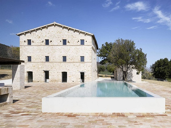 Italian House Renovation concrete and stone exterior Renovated House in Treia has All Charm Kept Intact