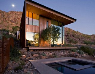Jarson Residence Dressed in a Weathered Steel and Cooper Skin