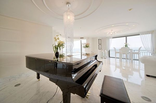 Luxury penthouse glossy living area with piano