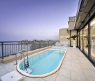 Luxury penthouse outdoor pool and glass living area