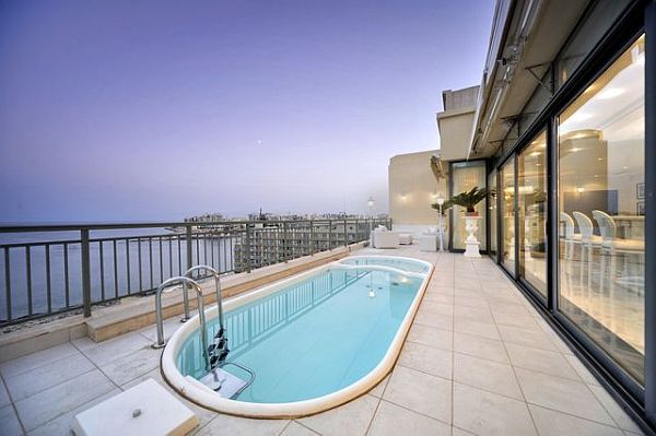 Luxury penthouse outdoor pool and glass living area Luxury Penthouse in Malta: New Heights Of Extravaganza