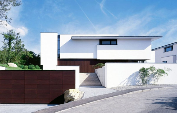 One shared facade two modern residences for Moderne architektur villa