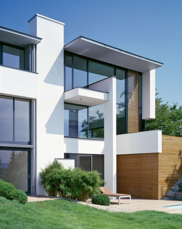 One shared facade two modern residences Architecture home facade