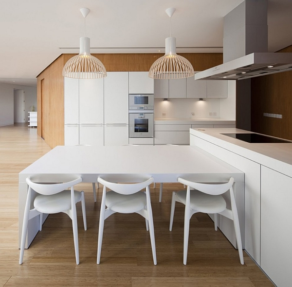 Mop House – minimalist kitchen with white furniture and island