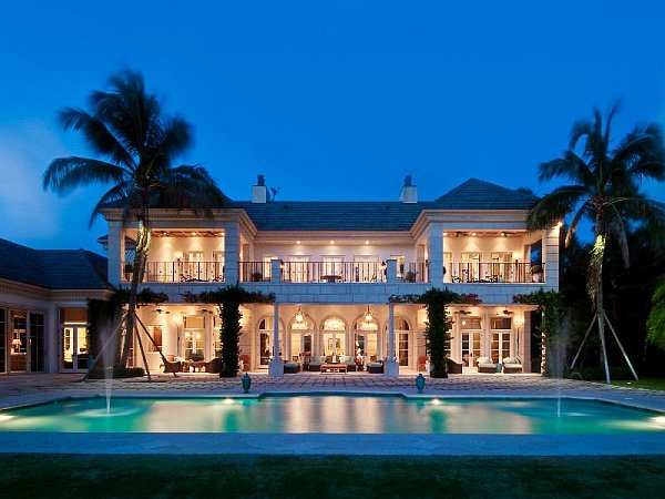 Beach Mansion at night with pool fountains Luxury Palm Beach Mansion ...