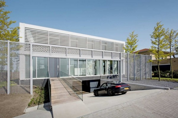 Steel Steady House garage design 600x399 Steel Steady House II in Holland is Poetry in Steel