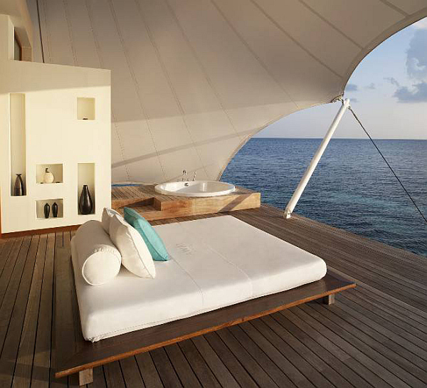 W Retreat and Spa in Maldives outdoor bed on wooden deck