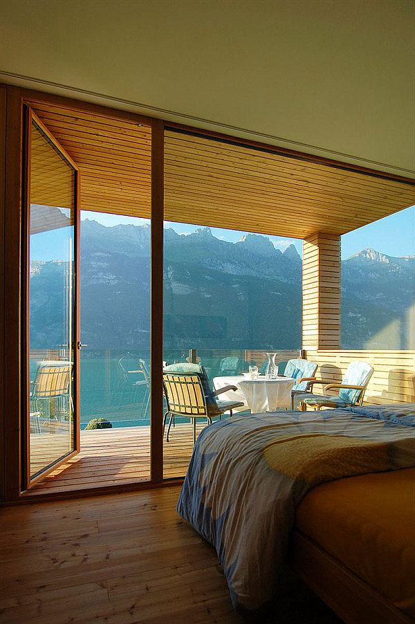 Wohnhaus Am Walensee – wooden bedroom with stunning lake mountain views