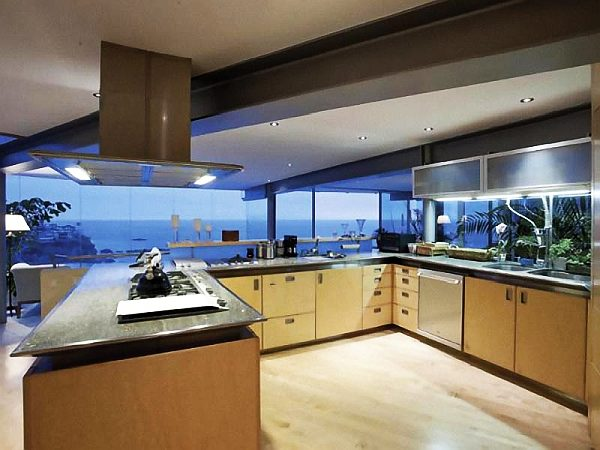 Beach house with ultra modern kitchen and stunning views for View kitchens ideas