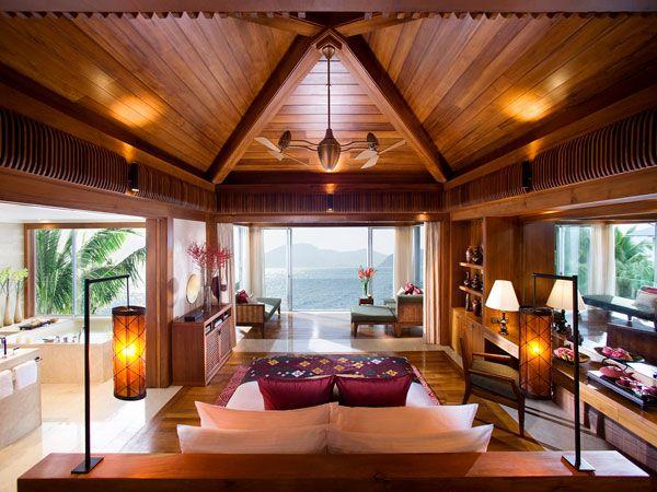 bedroom in resort villa with ocean & mountain views
