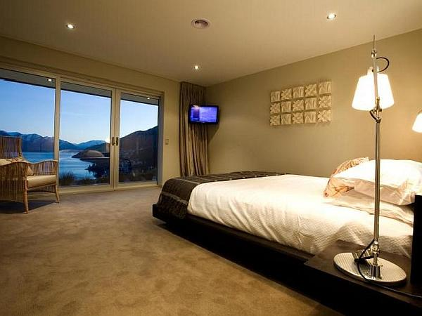bedroom with glass doors and stunning views