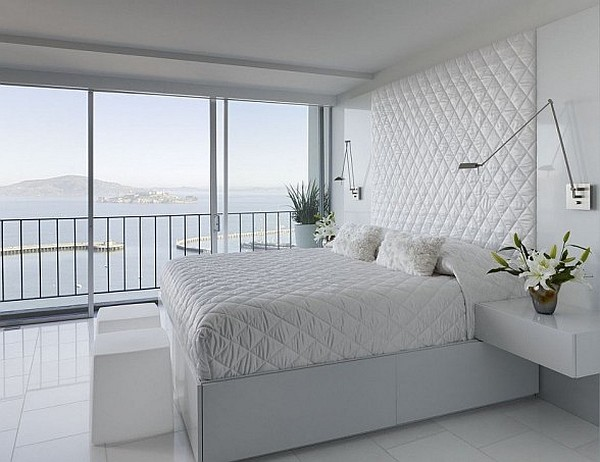 white bedroom interior with stunning views