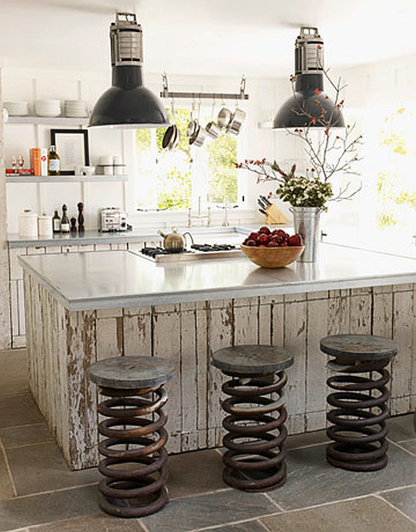 Airy KItchen with repurposed wood island and coil springs chairs Celebrate Earth Day by Using Repurposed and Upcycled Home Décor