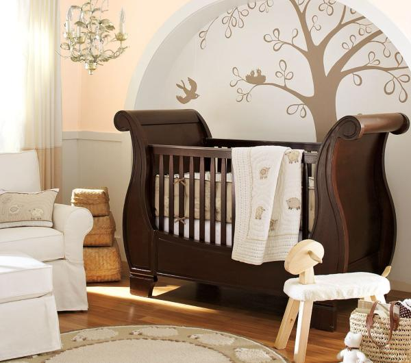 walls can also be defined with decals as shown in the nursery below for the baby of laila ali daughter of muhammad ali the metallic decals create the