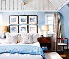 beautiful modern blue and white bedroom in attic