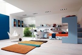 blue teen room with modern rug