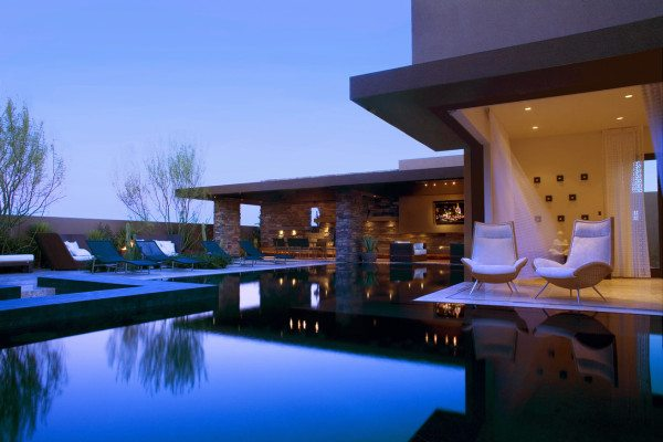 calm relaxing outdoor living with stunning blue pool 600x400 Creating a Backyard Oasis: 26 Sleek Pool Designs