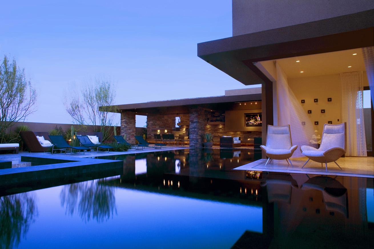 calm relaxing outdoor living with stunning blue pool
