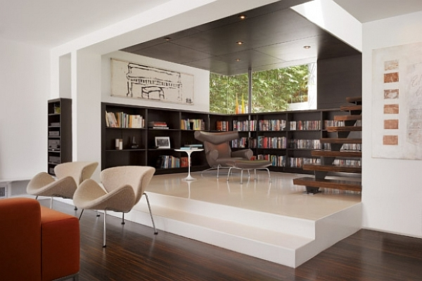 contemporary  designed living room with wood paneled library