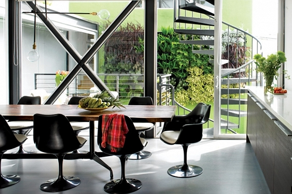 contemporary dining room with black chairs