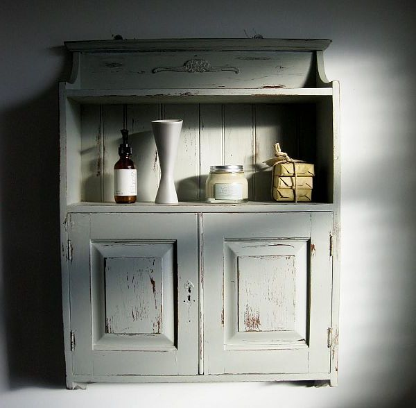 distressed bathroom cabinet after painting