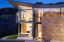 home perched on a cliff with ocean views 1 - glass walls