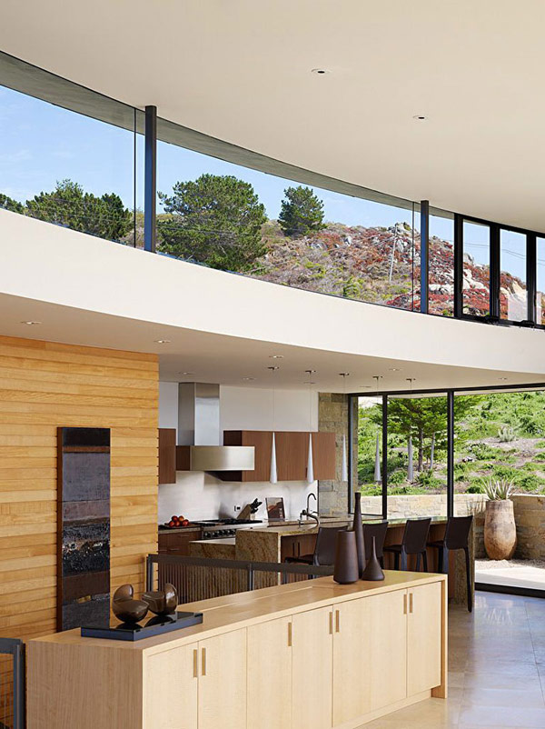 home perched on a cliff with ocean views 7 - wooden kitchen area with sleek dining space