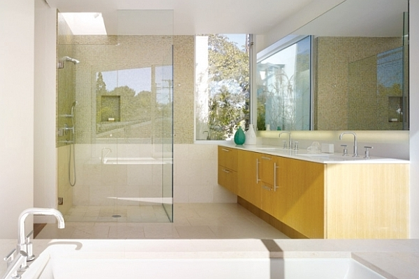 light colored bathroom with plenty of glass