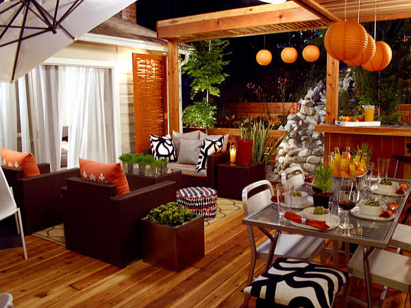 outdoor living room with orange decor