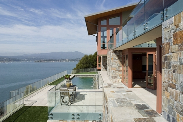 stone and glass house with pool