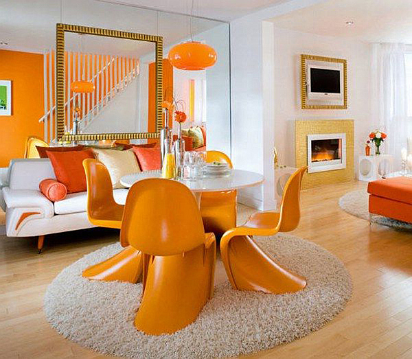 white and orange living and dining room