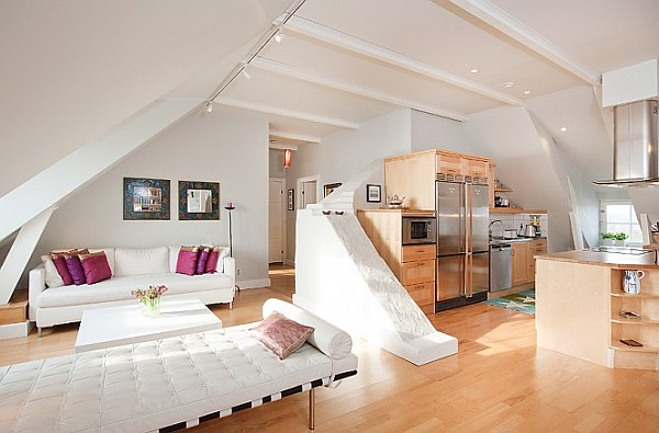 Stockholm attic apartment charms with its steep ceilings for Open space apartment