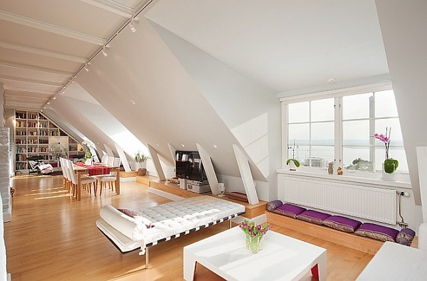 Attic Apartment Decoration 2 dining table in relaxing area Stockholm Attic Apartment Charms with Its Steep Ceilings