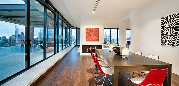 Clarendon Penthouse - large colorful dining area with fireplace and terrace view