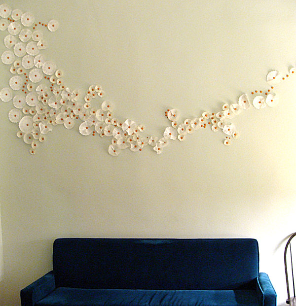 DIY cupcake wrapper and thumbtack wall art
