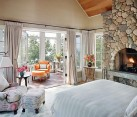 Lake House Bedroom with fireplace and colorful reading nook
